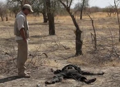 George Clooney stands by an unidentified body in Nuba, Sudan.