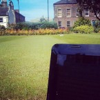 Transcribing in the summer sun on the front lawn at Queen's University Belfast.