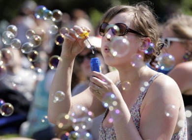 Forever blowing bubbles... Franzi Blum from Germany amuses herself at the Dublin City Soul Festival at Merrion Square today.