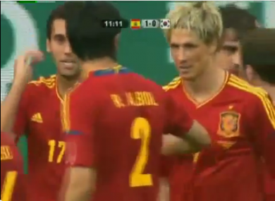Torres is congratulated by his teammates.