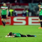 Athletic Bilbao's Iker Muniain lies dejected at the end of the Europa League final defeat to Atletico Madrid. 