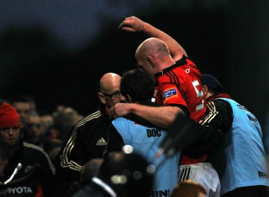 Munster's Paul O'Connell is helped from the field.