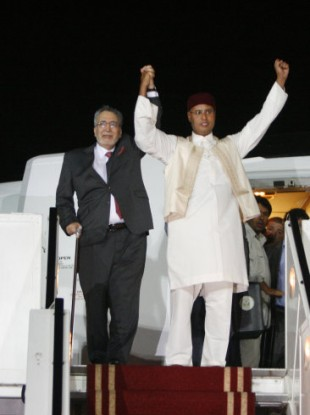 Abdel Basset al-Megrahi greeted by Seif al-Islam Gaddafi at Tripoli airport in 2009.