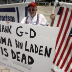 Doug Logan celebrates the death of Osama bin Laden at the Torch of Freedom, Monday, May 2, 2011, in Miami. (AP Photo/Jeffrey M. Boan)