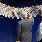 Greeks read newspapers hanging at a kiosk in Piraeus port, near Athens, on Tuesday, May 3, 2011.(AP Photo/Petros Giannakouris)