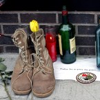 A tribute, including a pair of military boots, is left outside Firehouse 343 at the World Trade Center construction site on Tuesday, May 3, 2011, in New York. (AP Photo/Bebeto Matthews)