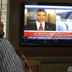 A Jordanian man reacts as he watch a TV news report about the killing of Osama bin Laden at a coffee shop in Amman, Jordan. (AP Photo/ Nader Daoud, File)