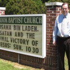 Rev. David Howard poses by a marquee outside Brook Baptist Church in Virginia Beach, Va, 5 May 2011. Howard changed his sermon after a Navy SEAL team based in Virginia Beach killed Osama bin Laden. (AP Photo/Brock Vergakis)