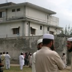May 5, 2011 file photo, local residents and media are seen outside the house where Osama bin Laden was caught and killed in Abbottabad, Pakistan. (AP Photo/Aqeel Ahmed, File)