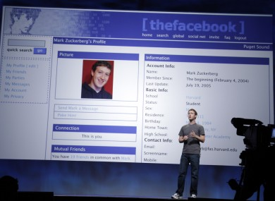 We've come a long way, baby: Mark Zuckerberg shows how his profile used to look at an event last year. Zuckerberg will make up to $1bn in cash from selling some Facebook shares this year.