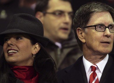 Liverpool co-owner John W Henry, right, stands with his wife Linda Pizzuti.