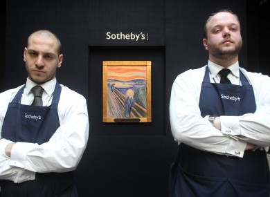 Sotheby's staff members stand guard over The Scream ahead of its auction earlier this month. 