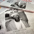 Afghan newspapers in Kabul, Afghanistan headlining the killing of al-Qaeda leader Osama bin Laden in May 2011. (AP Photo/Musadeq Sadeq, File)