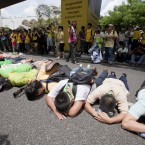 Protesters lie down on a major intersection in the central business district in Kuala Lumpur, Malaysia, Saturday, April 28, 2012. Thousands of people gathered near Kuala Lumpur's Independence Square to seek sweeping changes in polling regulations to curb fears of fraud in elections that many speculate will be held in June. (AP Photo/Mark Baker)