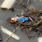 A doll lies in the water after a ferry capsized in the Brahmaputra River at Buraburi village, about 350 kilometers (215 miles) west of the state capital Gauhati, India, Tuesday, May 1, 2012. Army divers and rescue workers pulled more than 100 bodies out of a river after a packed ferry capsized in heavy winds and rain in remote northeast India, an official said Tuesday. At least 100 people were still missing Tuesday after the ferry carrying about 350 people broke into two pieces late Monday, said Pritam Saikia, the district magistrate of Goalpara district. (AP Photo/Anupam Nath)