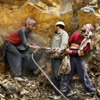Kashmiri laborers work at a stone quarry on the outskirts of Srinagar, India, Tuesday, May 1, 2012. May Day moved beyond its roots as an international workers' holiday to a day of international protest Tuesday, with rallies throughout Asia demanding wage increases and marches planned across Europe over government-imposed austerity measures. (AP Photo/Mukhtar Khan)