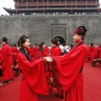 (CHINA OUT) More than 100 couples of newlyweds wearing Han Chinese clothes attend the collective wedding ceremony at Yongning Gate on May 1, 2012 in Xi'an, Shaanxi Province of China. (Photo by Jiao Hongtao/ChinaFotoPress)***_***427551215