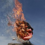An effigy of Bolivia's President Evo Morales flames after demonstrators set it on fire at a May Day event in La Paz, Bolivia, Tuesday, May 1, 2012. Morales announced Tuesday his government is completing the nationalization of the country's electricity industry by taking over its electrical grid from a Spanish-owned company. (AP Photo/Juan Karita)