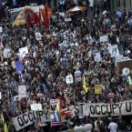 Protesters march down Broadway toward the financial district in New York, Tuesday, May 1, 2012. (AP Photo/Seth Wenig)