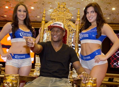 Floyd Mayweather Jr. poses for photos after arriving at the MGM Grand casino and hotel yesterday.