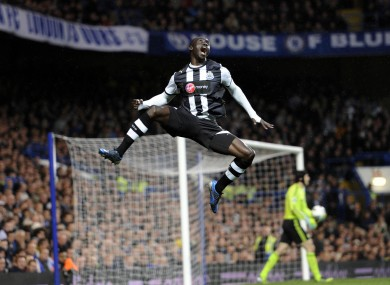 Cisse celebrates one of his two stunning goals.