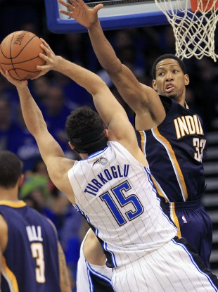 Indiana Pacers' Danny Granger defends a shot by Orlando Magic's Hedo Turkoglu.
