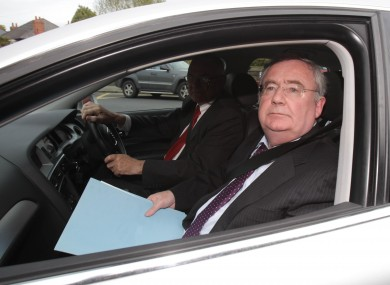Communications Minister Pat Rabbitte arrives at RTE studios yesterday following the publication of the report