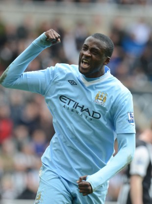 Yaya Toure celebrates a goal that sends City a long way to the title