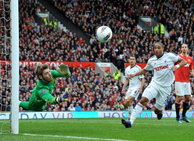 Manchester United goalkeeper David De Gea makes a good save against Swansea yesterday.