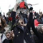 Supporters of President-elect Francois Hollande react after the results of the French Presidential elections at Bastille square in Paris, France, Sunday, May 6, 2012. (AP Photo/Laurent Cipriani)