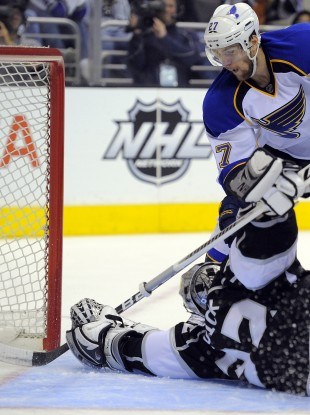 Los Angeles Kings goalie Jonathan Quick stops a shot by St. Louis Blues defenseman Alex Pietrangelo.