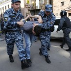 Police detaining protesters in downtown Moscow today. (AP Photo/Ivan Secretarev)