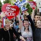 Pro-Putin Nashi movement members celebrate in downtown Moscow on Monday, May 7, 2012. Posters read: Putin loves all. (AP Photo/Ivan Sekretarev)