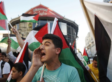 Palestinians at a rally with the Democratic Front for the Liberation of Palestine chant slogans supporting Palestinian inmates hunger striking in Israeli jails, in the West Bank city of Ramallah