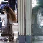 A woman begs for money in Milan, Italy, Tuesday, May 8, 2012. Several candidates opposed to austerity measures were making a strong showing Monday in Italy's local elections, partial results indicated, in the first nationwide test for Premier Mario Monti since he was named to save Italy from its debt crisis. Analysts watched for signs of voter anger in two days of balloting over Monti's austerity measures and toward mainstream parties that have supported them since Monti took over from Silvio Berlusconi in November. (AP Photo/Luca Bruno)