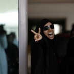 A Bahraini anti-government protester gestures outside a Manama, Bahrain, courthouse on Tuesday, May 8, 2012, where a defense lawyer says a civilian court has begun proceedings to re-examine convictions against a jailed hunger striker and 20 other activists. (AP Photo/Hasan Jamali)