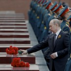 Russian President Vladimir Putin attends a wreath laying ceremony at the Tomb of Unknown Soldier on the eve of Victory Day celebration in Moscow, Russia, Tuesday, May 8, 2012. Russia is marking the surrender of Nazi Germany in World War II on May 9th. (AP Photo/Ivan Sekretarev)