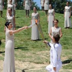The Olympic Flame is lit by an actress dressed as the High Priestess, during a rehearsal for tomorrow's ceremony, which signals to the world that the countdown to the London 2012 Games has begun, at the Temple of Hera in Olympia, Greece, where the ancient Olympic Games took place.