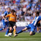 Wigan Athletic's Adrian Lopez challenges Wolverhampton Wanderers' Stephen Hunt during the Barclays Premier League match at the DW Stadium, Wigan - Jon Buckle/PA Wire/Press Association Images