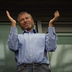 Chelsea's owner Roman Abramovich applauds during the Barclays Premier League match at Stamford Bridge, London - Rebecca Naden/PA Wire/Press Association Images