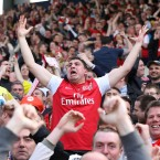 Arsenal fans celebrate in the stands as they head towards a Champions League spot - Nick Potts/PA Wire/Press Association Images