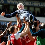 Arsenal assistant manager Pat Rice is thrown into the air by the Arsenal players after his final match - Nick Potts/PA Wire/Press Association Images