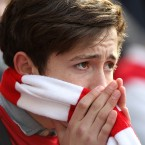 A nervous Arsenal fan in the stands - Nick Potts/PA Wire/Press Association Images