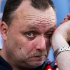 A Bolton Wanderers' fan wipes tears away as his team are relegated - John Walton/EMPICS Sport