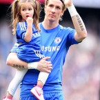 Chelsea's Fernando Torres waves to the crowd with his daughter after the game - Adam Davy/EMPICS Sport