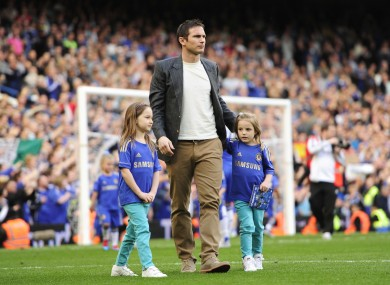 Chelsea's Frank Lampard walks around the Stamford Bridge pitch with his daughters last Saturday.