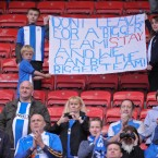 Wigan Athletic fans prompt the team to stay on and build during the Barclays Premier League match at the DW Stadium, Wigan - Jon Buckle/PA Wire/Press Association Images