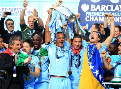 Vincent Kompany and Manchester City celebrate a remarkably-won trophy