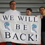 Bolton Wanderers' fans with a banner after the end of the match after they are relegated - John Walton/EMPICS Sport