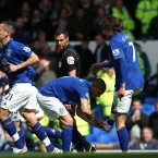 Everton's Nikica Jelavic (right) celebrates scoring his side's second goal of the match with teammate Johnny Heitinga (left) -  PA Wire/PA Wire/Press Association Images
